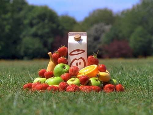 innocent advert with smoothie carton with fruit in park