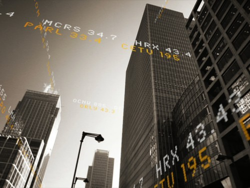 Stock ticker symbols around canary wharf buildings