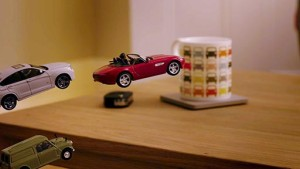 Toy cars jumping across a table